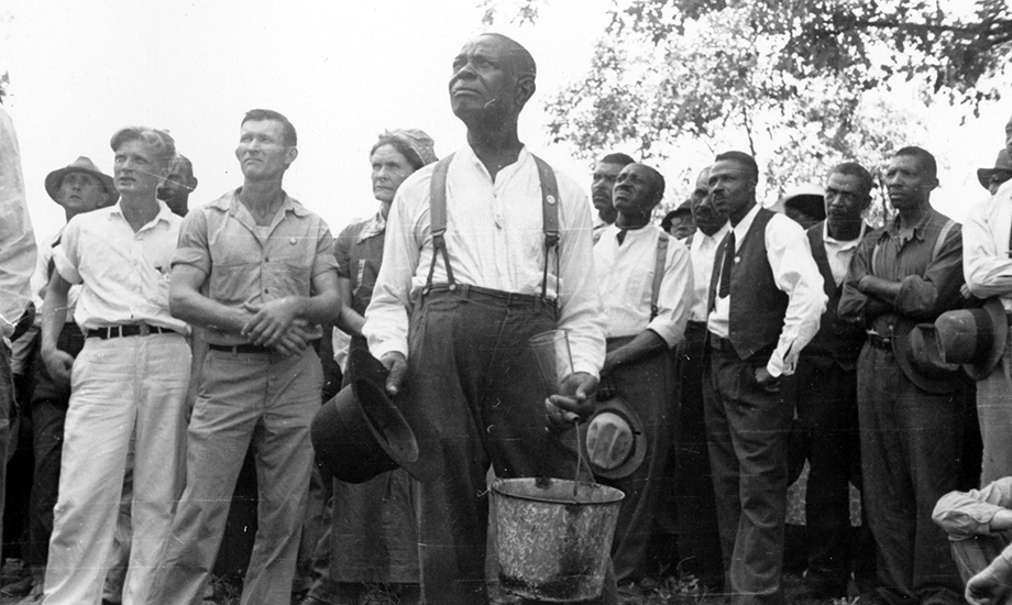 Photograph of black and white workers